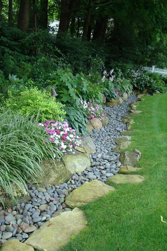 Edge Your Yard With Plants And Small Rocks To Direct The Water