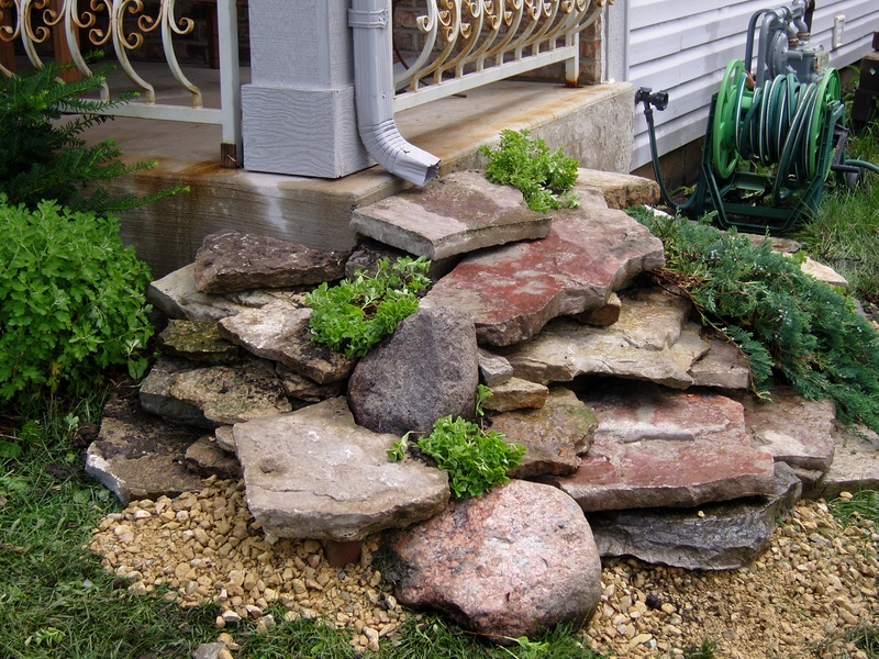 Use landscaping rock to create a fountain - 11 Attractive Landscape Drainage Solutions - Frador