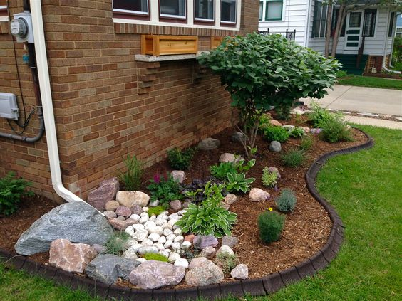 Disguise the gutter with nice landscaping additions - 11 Attractive Landscape Drainage Solutions - Frador